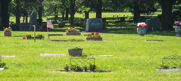 photo of headstones and memorials in a graveyard