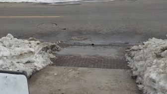 JPG of sidewalk curb cut cleared of all ice and snow