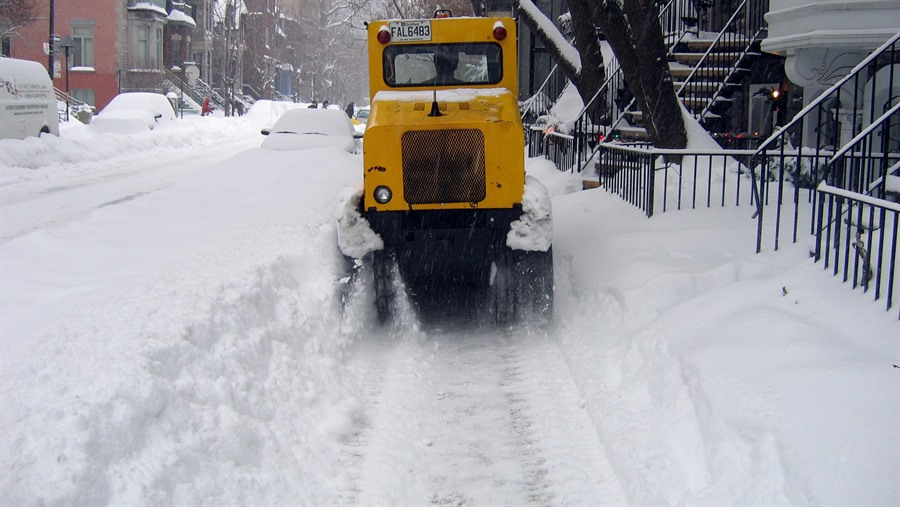 JPG image of plow clearing a sidewalk of snow - Photo Credit to Simon Law https://www.flickr.com/photos/sfllaw/74490693