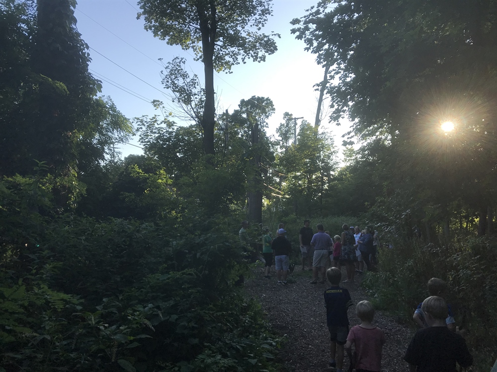 Photo of visitors enjoying a hike in Burton Woods