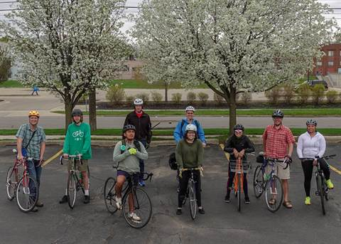 JPEG image of a group of men and women on bicycles