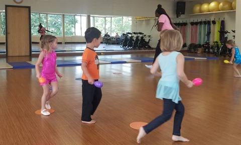 JPEG image of kids running in a creative dance class