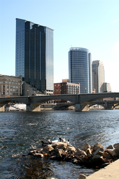 JPEG image of the Grand River with the downtown skyline and bridges in the background