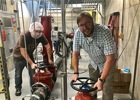 Cody Green, Environment, Health, & Safety Specialist (left) and Brad Stevenson, Chief Production Officer switch their waste flow to discharge into the City's concentrated waste pipeline.