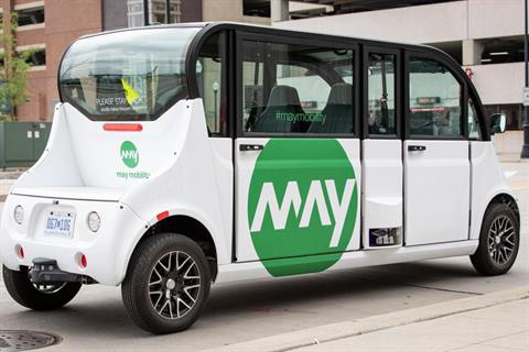 Photo of a May Mobility six-seat electric shuttle
