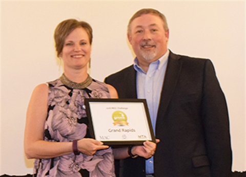 Alison Waske Sutter, the City's sustainability manager, accepts the Michigan Green Communities Network's gold certification certificate