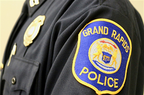 GRPD patch and badge on a Grand Rapids police officer