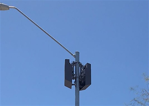 Image of a small cell device on a light pole